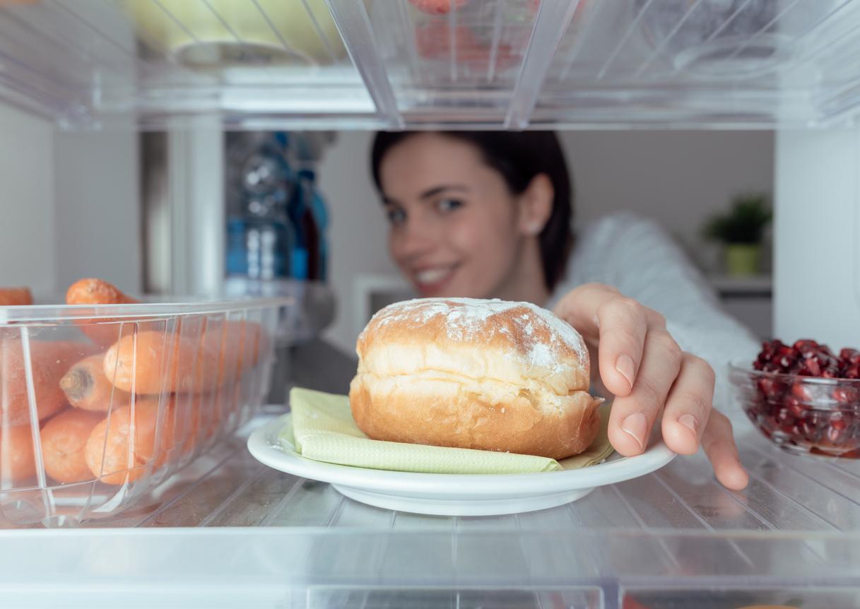 Woman having an unhealthy snack